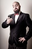 Funny elegant bearded man on the phone Stock Photos