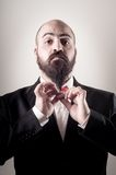 Funny elegant bearded man touching beard Royalty Free Stock Image