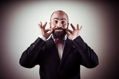 Funny elegant bearded man touching mustache Stock Photography
