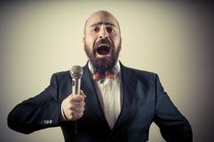 Funny elegant singer bearded Stock Photo