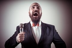 Funny elegant singer bearded Stock Photos