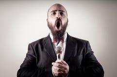 Funny elegant singer bearded Royalty Free Stock Photography
