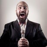 Funny elegant singer bearded Stock Photo