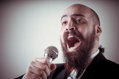 Funny elegant singer bearded Royalty Free Stock Photos