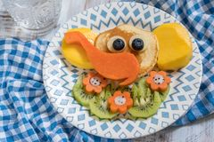 Funny elephant pancakes for kids breakfast. Funny elephant pancakes with fruits for kids breakfast royalty free stock photography