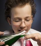 Funny emotional chemist with two flasks.  royalty free stock photo
