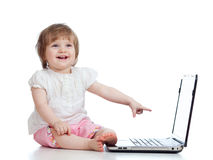 Funny emotional child girl using a laptop Royalty Free Stock Image