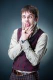 Funny emotional young man. Studio shot Royalty Free Stock Photo