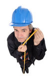 Funny engineer with a measuring tape. Isolated on white royalty free stock photography
