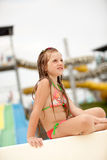 Funny excited child enjoying summer vacation in water park Stock Images