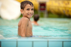 Funny excited child enjoying summer vacation in water park Royalty Free Stock Photography