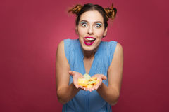 Funny excited woman holding jelly candies and showing tongue Royalty Free Stock Images