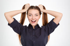 Funny excited young woman with two ponytails holded by hands Stock Photo