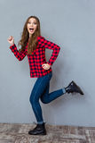 Funny exciting girl running Royalty Free Stock Image