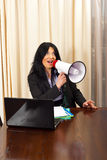 Funny executive shouting away in megaphone Stock Photography