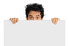 Funny expression. Man in funny expression holding a big blank card Stock Photography