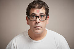 Funny expression. Man with glasses funny blank expression Royalty Free Stock Photos
