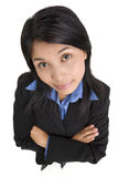 Funny expression. A young business woman is looking at the camera with funny expression Royalty Free Stock Photos