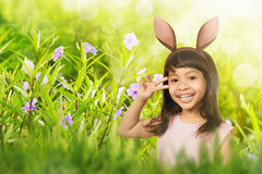 Funny expression child girl with bunny ears Stock Photos