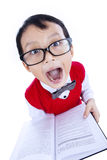 Funny expression of nerd boy holding book - isolated Royalty Free Stock Photos