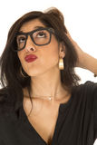 Funny expression woman puckered lips wearing geek glasses Royalty Free Stock Photos