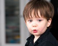 Funny expressions of a toddler Royalty Free Stock Photography