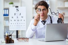 The funny eye doctor in humourous medical concept. Funny eye doctor in humourous medical concept Royalty Free Stock Photography