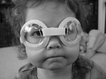 Funny Face. Toddler wearing goggles that distort her face Stock Photography