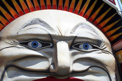 Funny face. Huge face of a clown in a theme park Stock Image