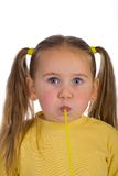 Funny face. Kid blowing a straw, isolated on white Royalty Free Stock Photography
