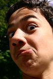 Funny face. Comic teen portrait outdoor. Close-up stock photography