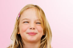 Funny face. A little girl making a funny face with crossed eyes royalty free stock photography