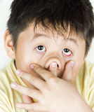Funny face. A boy with his funny face stock photography