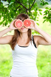 Funny face. Young woman having fun with fruits Royalty Free Stock Photo