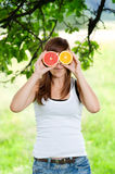 Funny face. Young woman having fun with fruits Stock Image