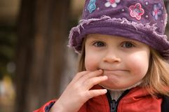 Funny face. Girl wearing hat outdoor with funny face expression Royalty Free Stock Photo