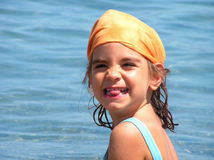 Funny face. Girl on the beach, making a teasing expression Stock Images