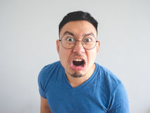 Funny face of angry Asian man. Royalty Free Stock Images
