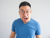 Funny face of angry Asian man. Stock Photos