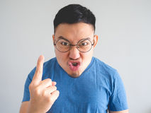 Funny face of angry Asian man. Royalty Free Stock Photo