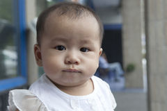 Funny face of asian baby in home living room Stock Image