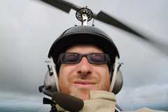 Funny face in autogyro. Pilot's self-portrait during the autogyro flight Royalty Free Stock Photo