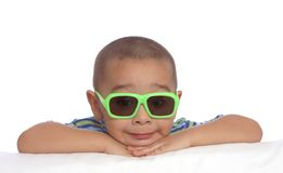 Funny Face Boy. Portrait of a young child wearing sunglasses and a cute smile royalty free stock photos