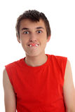 Funny face boy with dracula teeth candy. A boy pulling a funny face with a dracula teeth confectionary soft candy in his mouth Royalty Free Stock Photography