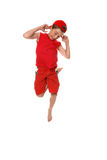 Funny face boy hopping. A boy hopping up and down and making faces Royalty Free Stock Photos