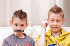 Funny face boys and mustaches Royalty Free Stock Photography