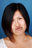 Funny face chinese girl Stock Photo