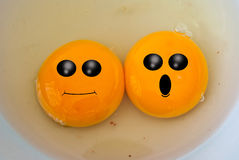 Funny face on egg yolk Stock Photography