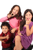 Funny face and gesture kids. Cute kids playing making funny faces and gestures, two adolescent girls one little toddler boy royalty free stock image