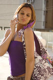 Funny face girl on cellphone. Beautiful girl having fun talks on cellphone stock images